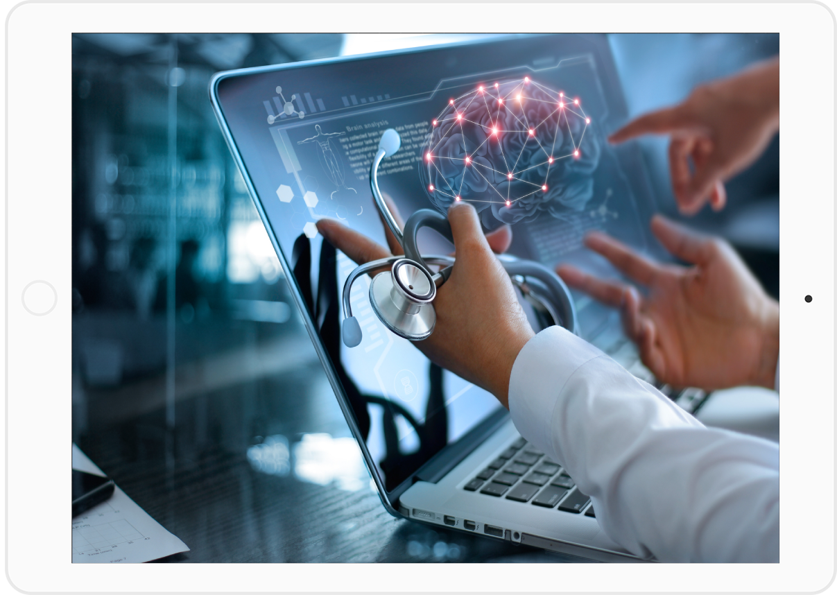 two doctors pointing to a laptop that is using artificial intelligence